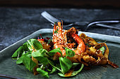 lunch dinner dish meal in a gourmet restaurant. food fish elegant gourmet plate. sea seafood shrimp on black plate