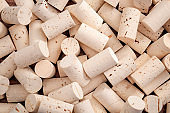 Winemaking cellar, winery backgrounds and selection of fine wines concept with full frame shot of wine bottle corks that create a pattern background
