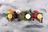 Sauces Assortment. Set of various sauces in bowls with ketchup, mayonnaise, pesto and mustard. Variety of induvidual marinades.