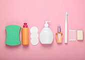 Beauty, health care, bath products and accessories on a pink background. Flat lay. Top view