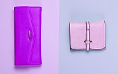 Minimalist fashion. Women's fashion accessories on a pastel background. Two leather purses, bag. Top view