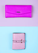 Women's fashion accessories on pastel background. Leather purse, wallet. Top view