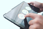 person giving negative feedback by touching smiley face on digital tablet touch screen