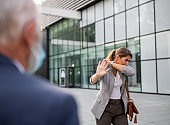 Business woman coughing and showing stop sign to colleague