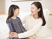 young asian mom enjoying time together with daughter