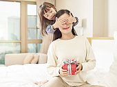 lovely asian little girl and young mother
