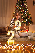 Little girl decorating home for New Year's Eve