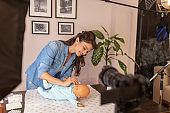 Influencer filming video about cleaning baby ears