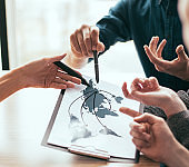 close up. a group of employees discussing ideas for a new startup. Elements of this image furnished by NASA