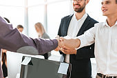 close up. young business people greeting each other with a handshake