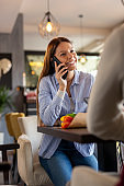 Woman speaking on the phone while on date