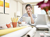 young asian business woman working at home