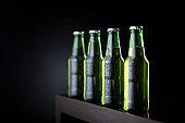Bottles of cold beer on bar counter
