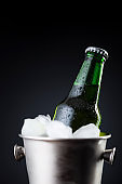 Beer bottle in an ice bucket