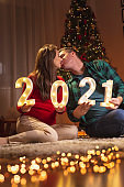 Couple kissing at midnight for New Year's Eve