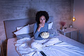Woman watching movie in bed