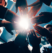 close up. group of young business people joining their palms together
