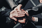 close up. young business people joining their palms together