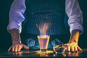 Bartender serving burning cocktail