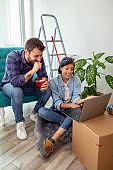 Couple redecorating apartment