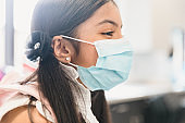 Profile photo girl smiling while wearing protective mask