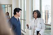 Medical colleagues discuss patient