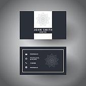 Elegant business card design with a mandala design