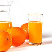 glass of fresh orange juice with fresh fruits on white background