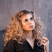 Girl curly hair. Image beauty salon