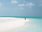 Beautiful Young Woman Run on the Maldivian Beach.
