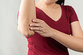 elbow pain, young women injuredm, healthcare and medical concept