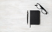 Notepad, glasses, pencil