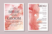 wedding invitation with pink watercolor waves or fluid art in alcohol ink style with gold on a white.
