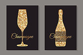 Golden glitter glass and bottle for champagne on a black background.