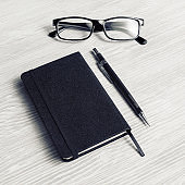 Notepad, glasses and pencil