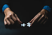 Closeup hand of businessman connecting jigsaw puzzle, Business solutions, success and strategy concept