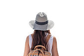 Rear of young asian female traveler with long hair, backpack and hat