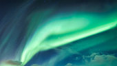 Aurora Borealis, Northern Lights covered in the night sky on Arctic Circle