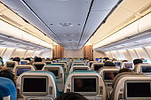Airline seat rows with digital display