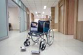 Empty wheelchair on corridor in the hospital