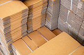 Stack of brown folded cardboard boxes tied