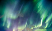 Aurora borealis, Northern lights swirl with star in the night sky