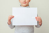 Mockup sheet of paper in child's hands.