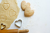 Making homemade heart shaped cookies from ginger raw dough - festive homemade cookies pastry for Valentine day