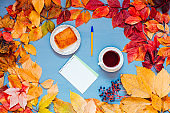 yellow and red autumn cup of coffee notebook desktop
