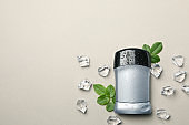 Body deodorant, ice and leaves on gray background, blank space for text