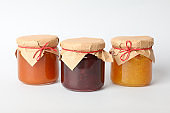 Glass jars with jam on white background. Sweet food