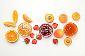 Composition with jam and ingredients on white background, top view