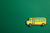 Decorative school bus on green background, space for text