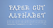 Paper cut alphabet. Flying 3D font, realistic paper cutouts style. Funny cartoon curly letters, numbers, punctuation marks